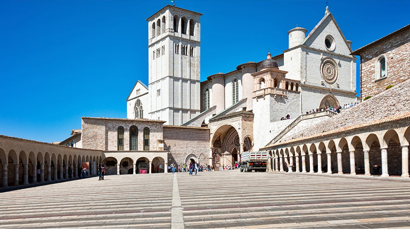 Assisi: the Basilica of St. Francis, UNESCO World Heritage.Assisi has been the center of the Franciscan Cult and the movement's diffusion throughout the world, focusing on a message of peace and tolerance, especially in regard to other religions.